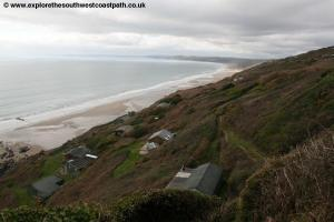 Huts along the coast at Whitsand Bay